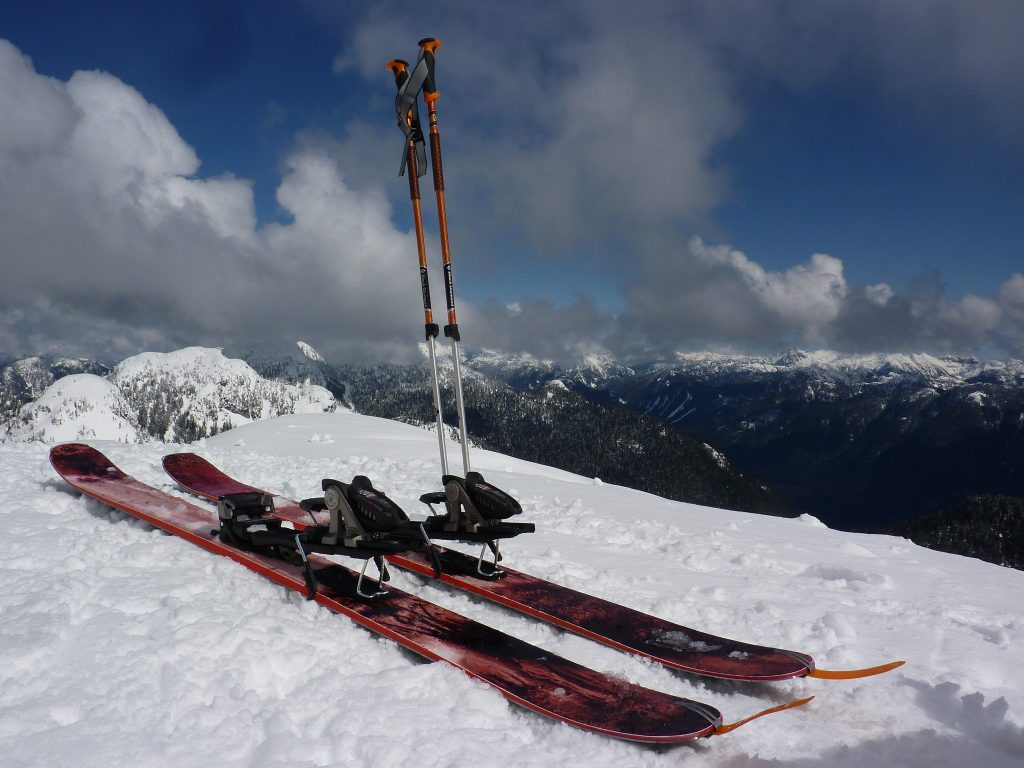 skis and poles on a moutain